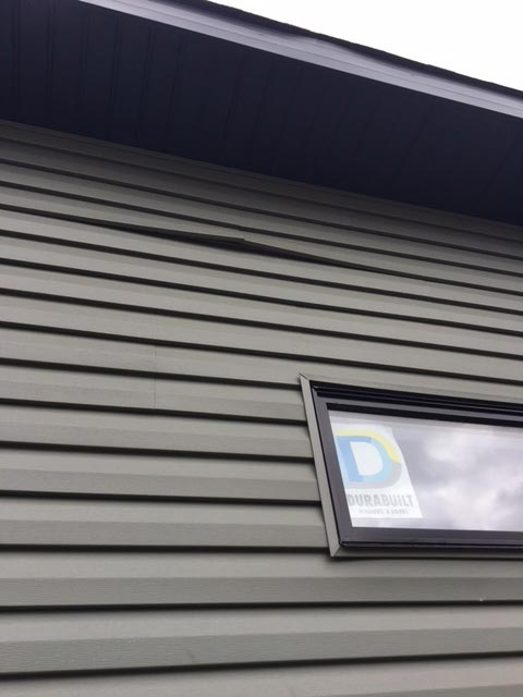 Repair - Popped out siding